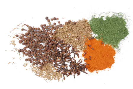Color spices isolated on white. photo
