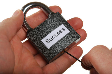 latchkey: Lock with an inscription success with a latchkey Stock Photo
