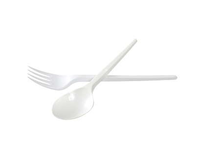 tine: plastic disposable fork and spoon is isolated on a white background