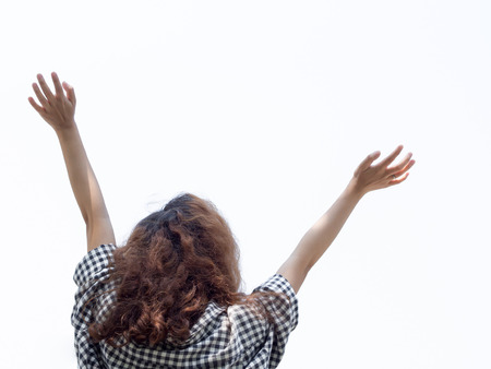 woman hands up: Girl raise hands up with happiness white background
