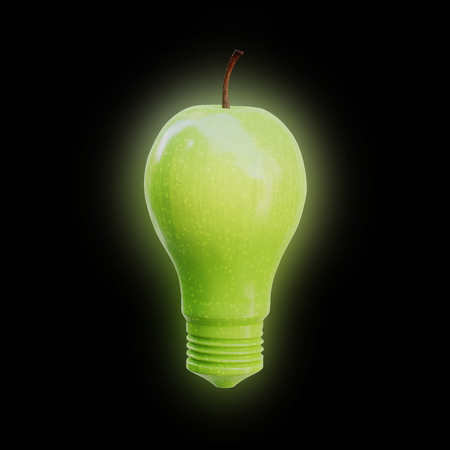 Apple shaped as a light bulb glowing on black background. Innovation, idea and creativity concept. Фото со стока