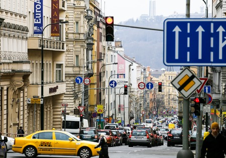 Many cars driving in the streets of Prague