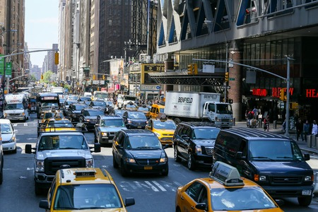 hectic: Many cars driving through a congested street in NY Editorial