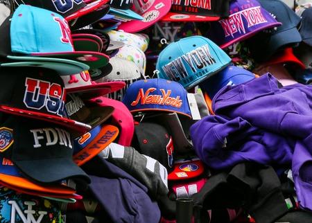 market stall: A variety of baseball caps at a market stall Editorial