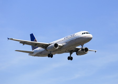 Airplane of United Airlines landing in Los Angeles Editorial