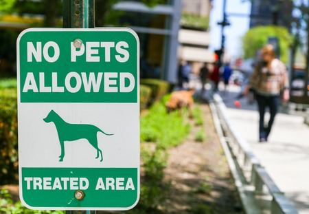 chicago: Area in Chicago where no pets allowed - in the background a woman walking her dog Stock Photo