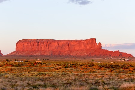the sentinel: The rock formation Sentinel Mesa in Monument Valley in evening light. Stock Photo