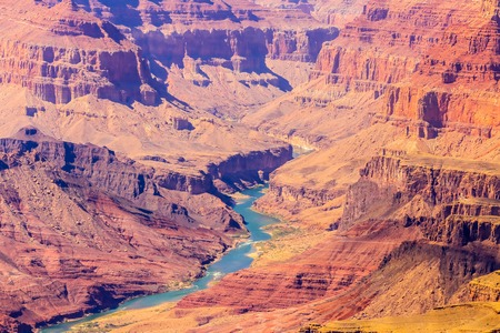 colorado river: The Colorado River is meandering through the steep walls of the Grand Canyon in Arizona. Stock Photo