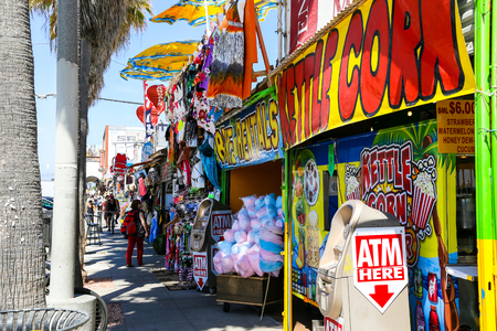 Several colorful shops at the boardwalk in Venice Beach, USA.