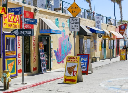 advertise with us: Several colorful snack shacks in a row in Venice Beach, USA.