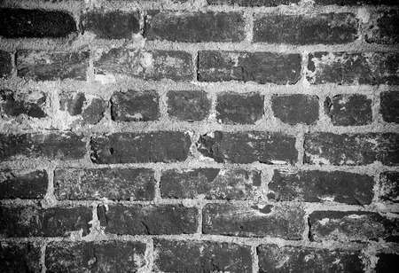 spotlight white background: Section of a brick wall with spotlight in monochrome.