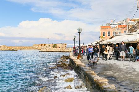 waterside: People strolling along the waterside promenade of Chania in Crete, Greece. Editorial