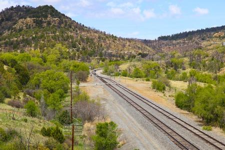 mountainous: Railroad tracks in mountainous landscape near East Raton in New Mexico, USA.