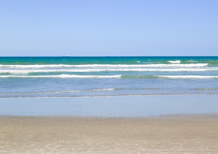 the surge: The surge of the Atlantic Ocean with a piece of beach in Cocoa Beach in Florida.