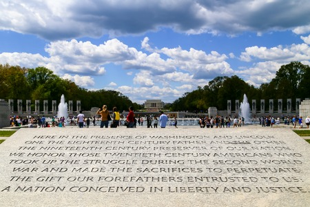 Close up of the engraving at the National World War II Memorial in Washington DC with the Lincoln Memorial in the back.