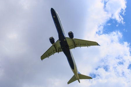 An airborne Jetblue aircraft seen from below in Washington DC.