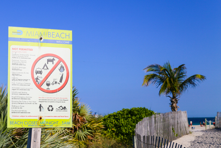 permitted: A prohibition sign in Miami Beach showing not permitted activities on the beach.
