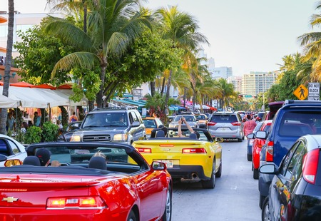 The Ocean Drive in Miami Beach crowded with cars and people. Editorial