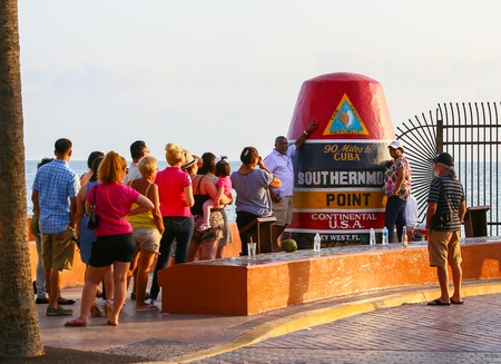 southernmost: People standing in line to take a picture of themselves at the Southernmost Point Continental USA in Key West.