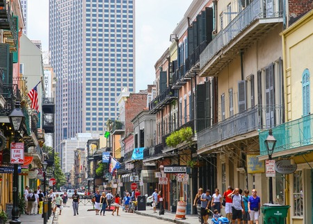highrises: New Orleans, USA - May 14, 2015: View of Royal Street in French Quarter with its historic architecture, in the back modern highrises. Many people are strolling down the street. Editorial
