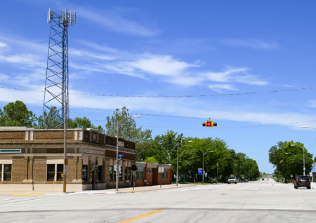 great plains: Moundridge, Kansas, USA - May 17, 2015: Junction with a telegraph pole and traffic light hanging above the street.