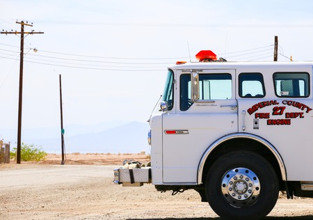aridness: Bombay Beach, California, USA - May 26, 2015: Parked white fire engine of the Imperial County Fire Department.