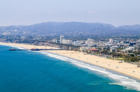Los Angeles, USA - May 27, 2015: Aerial view of Santa Monica State Beach, in the back residential buildings, Santa Monica Pier and the mountains.