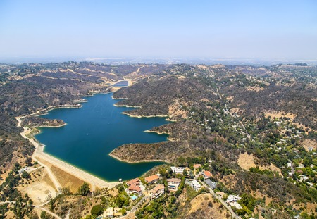 bel air: Los Angeles, USA - May 27, 2015: Aerial view of the Stone Canyon Reservoir in Bel Air. There are some estates built next to the lake. Editorial