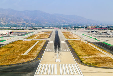 Burbank, USA - May 27, 2015: Aerial view of the airport with runways, hangars and parked airplanes.