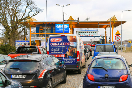 get across: Swinoujscie, Poland - February 21, 2017 - Many cars waiting to get on board a ferry across the piast canal.