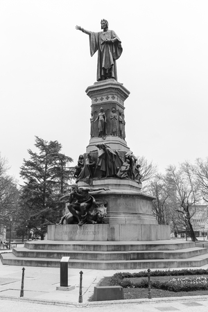 dante alighieri: Trento, Italy - March 21, 2017: Statue of the Italian poet Dante on the square named after him. The picture is monochrome.