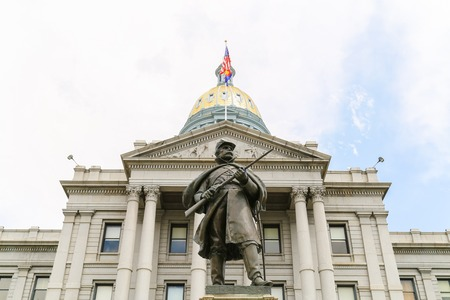 denver buildings: Denver, USA - May 25, 2016: Front view of the Colorado State Capitol including the gold dome with the Civil War Monument in front. Editorial
