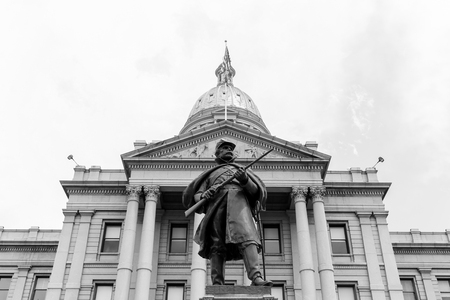 Denver, USA - May 25, 2016: Front view of the Colorado State Capitol including the gold dome with the Civil War Monument in front. The picture is in monochrome. Editorial
