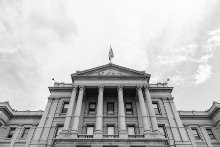 denver buildings: Denver, USA - May 25, 2016: Looking up view of the facade and the entrance of the Colorado State Capitol. The picture is in monochrome.