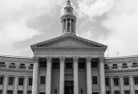Denver, USA - May 25, 2016: Front view and entrance of the City and County Building of Denver. The picture is in monochrome.