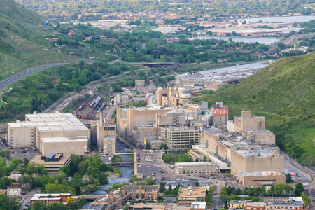molson: Golden, USA - May 26, 2016: Overlook of the Coors brewery in Colorado with several buildings, roads and tracks with cars and trains and a creek running through the facility.