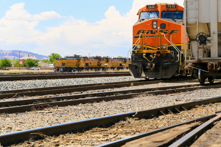 Grand Junction, USA - May 28, 2016: Engines of the companies Union Pacific and BNSF standing on the tracks at the train station.