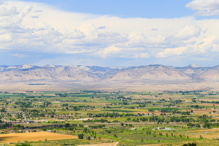 View of the Book Cliffs with the city of Fruita in Colorado in front. Stock Photo