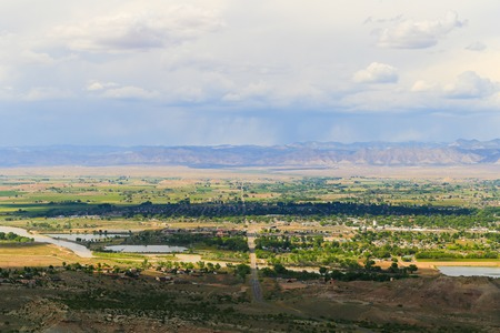 View of the city of Fruita in Colorado seen from the Colorado National Monument with the Gunnison River in front and the Book Cliffs in the back.