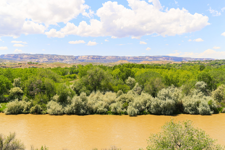 The Gunnison River near Grand Junction in Colorado with the Book Cliffs in the back.