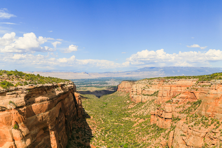 The Red Canyon in the Colorado National Monument with the Grand Mesa and the Book Cliffs in the back.