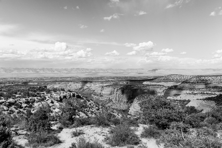 Part of the Colorado National Monument with the Book Cliffs in the back. The picture is in monochrome.