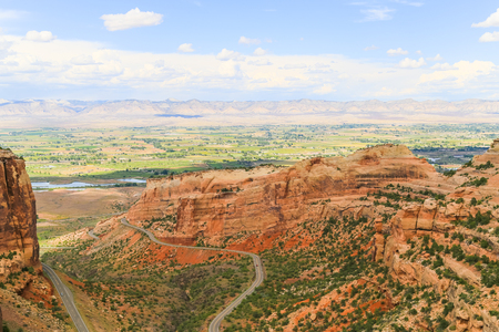 Part of the Colorado National Monument with the Rim Rock Drive and the Book Cliffs in the back.