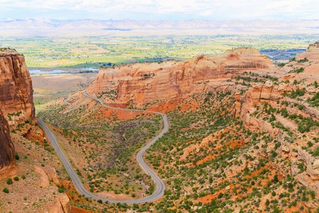 The Rim Rock Drive, the road going through the Colorado National Monument, winding through the  Fruita Canyon. In the back the Book Cliffs.