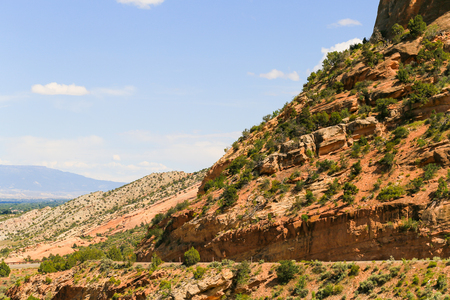 Part of the Rim Rock Drive, the road going through the Colorado National Monument, with part of the Grand Mesa in the back.