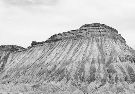 Part of the desert mountains Book Cliffs near Grand Junction in Colorado. The picture is monochrome. Stock Photo