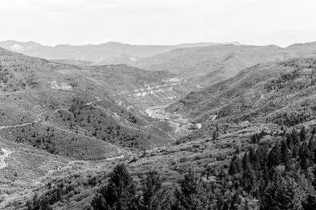 Overlook of mountains and canyons on the Colorado State Highway 139, called Douglas Pass Road. The picture is monochrome. Stock Photo