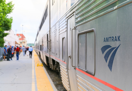 Grand Junction, USA - May 29, 2016: Platform with passengers getting on board the Amtrak passenger train California Zephyr. Redakční