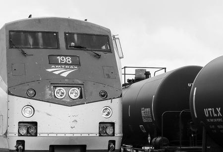 Grand Junction, USA - May 29, 2016: Engine of the Amtrak passenger train California Zephyr at the station with a freight train behind. The picture is monochrome. Editorial