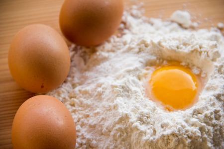 white flour and eggs on the table Stock Photo